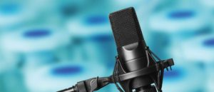 QuayCast header image showing a microphone